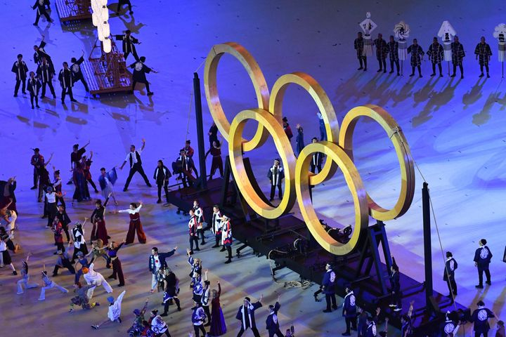 An overview shows performers assemble the Olympic Rings during the opening ceremony.