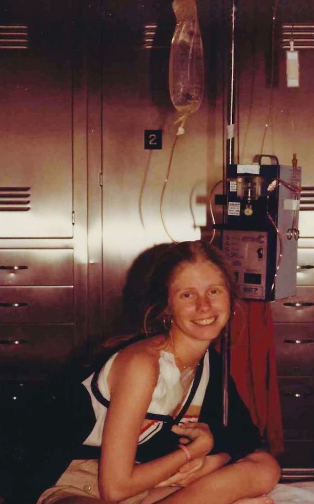 The author, age 26, in the hospital for issues related to her Crohn's disease.