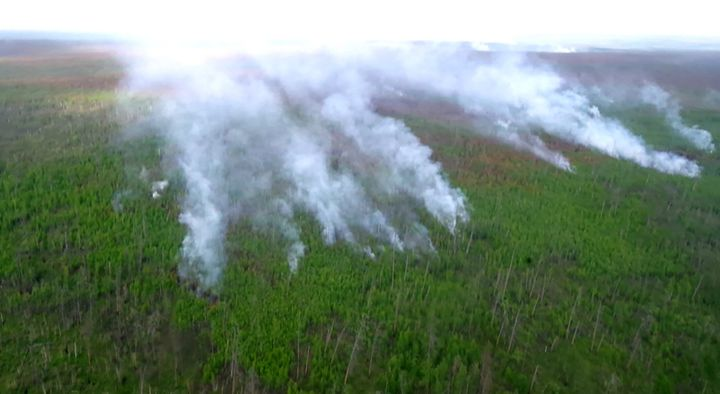 A view of a wildfire from a helicopter in Yakitua on July 22, 2021.