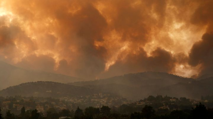 Smoke spreads over Parnitha mountain during a wildfire in Ippokratios Politia village, about 35 kilometres (21 miles), northe