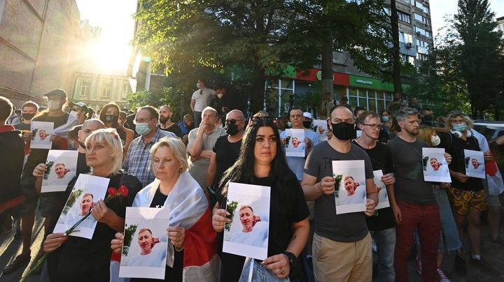 Activists attend a rally outside the Belarus embassy in Kiev on August 3, 2021, in memory of Vitaly Shishov. (Photo by SERGEI