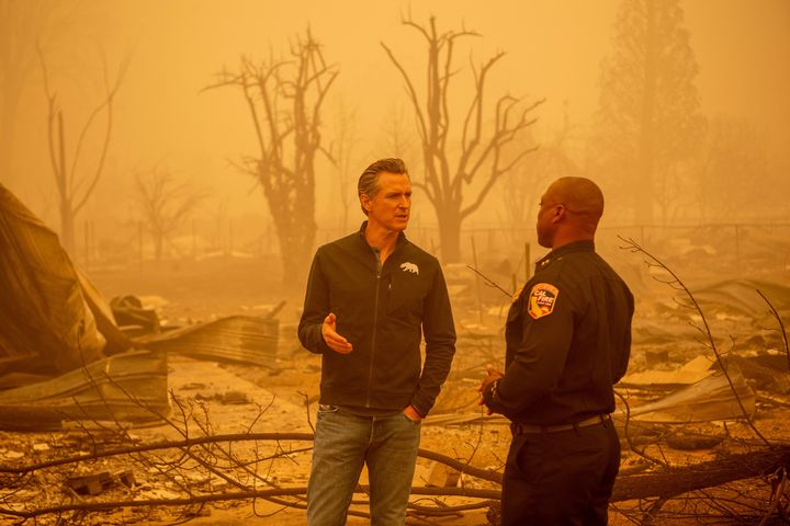 Newsom tours an area destroyed by wildfires in August.