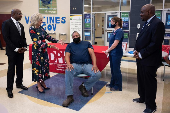 First lady Jill Biden is seen at a vaccination facility in Savannah, Georgia, on July 8, as Alfred Lee Smith (C) was vaccinat