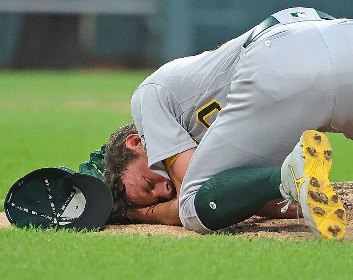 Starting pitcher Chris Bassitt of the Oakland Athletics was hit in the head by a line drive from Brian Goodwin of the Chicago