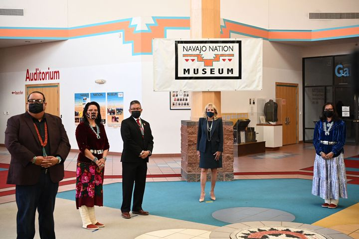 First Lady Jill Biden (C) is greeted by Navajo Nation President Jonathan Nez (out of frame) and his wife Phefelia Nez (R) upo