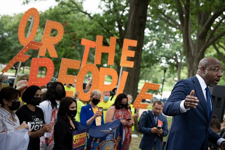 U.S. Sen. Raphael Warnock (D-Ga.) speaks to people rallying for voters' rights on Capitol Hill on Aug. 3, 2021.