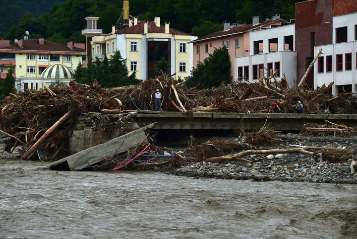 A man watches the destruction after floods and mudslides killed about three dozens of people, in Bozkurt town of Kastamonu pr